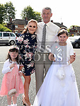 Eleshia Thornton from St Brigids school who received her Fiirst Holy Communion in Our Lady of Lourdes church pictured with dad Michael and sisters Kimberly and Georgia. Photo:Colin Bell/pressphotos.ie