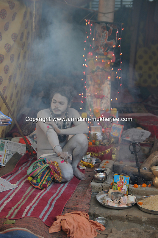 A Naga Sadhu (naked saint) sitting in his tent at Kumbh mela on 13th February 2010. Haridwar, Uttara Khand, India, Arindam Mukherjee
