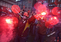 Seattle Sounders fans burn road flares during the march to the match before play between the Seattle Sounders FC and the L.A. Galaxy at Qwest Field in Seattle Tuesday March 15, 2011. The Galaxy won the game 1-0.