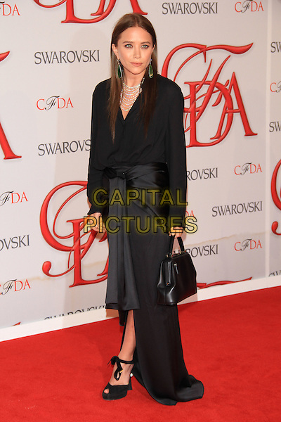 Mary-Kate Olsen.The 2012 CFDA Fashion Awards held at Alice Tully Hall - Lincoln Center, New York, NY, USA..June 4th, 2012 .full length dress black blouse skirt hand bag purse .CAP/LNC/TOM.©LNC/Capital Pictures.