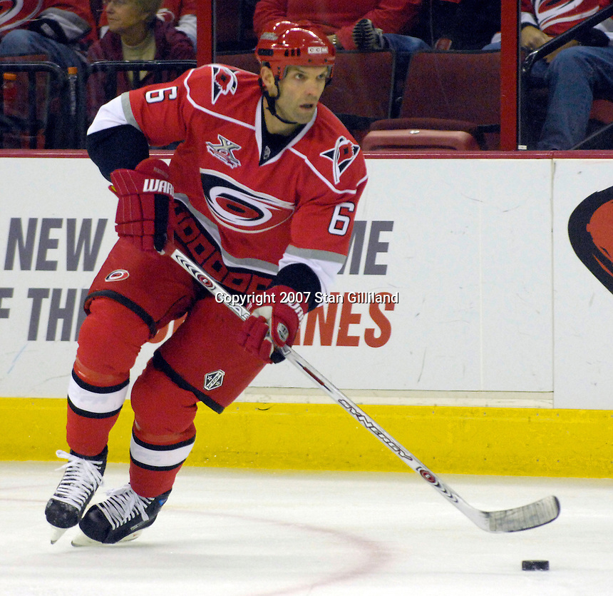 Carolina Hurricanes' Bret Hedican brings the puck up ice during a game with the Montreal Canadiens Friday, Oct. 26, 2007 in Raleigh, NC. The Canadiens won 7-4.