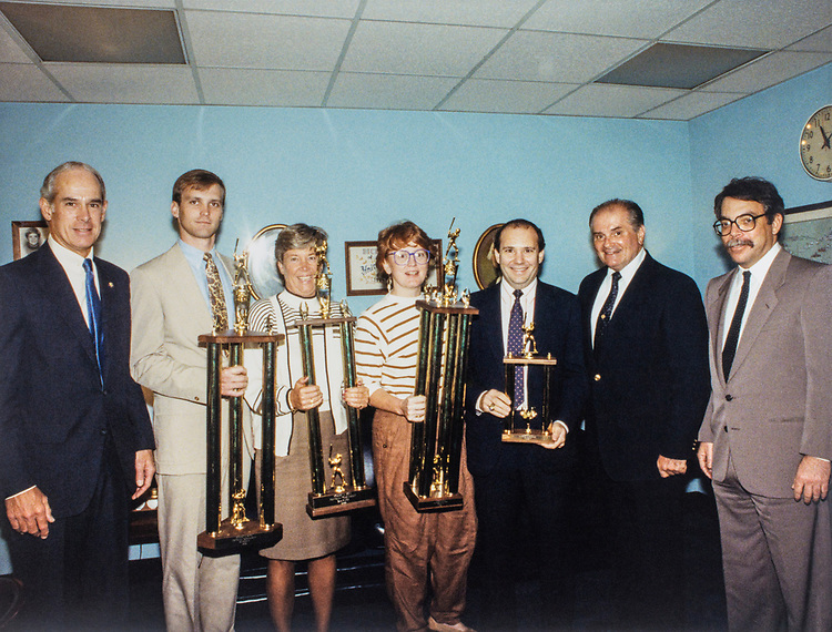 Rep. John Porter, R- Ill., with Bob Rota and other party members holding trophies. 1989 (Photo by CQ Roll Call)