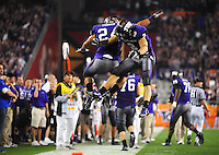 Jan. 4, 2010; Glendale, AZ, USA; TCU Horned Frogs wide receiver (2) Curtis Clay celebrates tailback (24) Joseph Turner after his second quarter touchdown against the Boise State Broncos in the 2010 Fiesta Bowl at University of Phoenix Stadium. Mandatory Credit: Mark J. Rebilas-