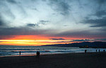 People watching the sunset at Santa Monica Beach in Los Angeles, CA