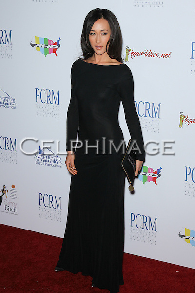 MAGGIE Q (Margaret Denise Quigley). Red Carpet arrivals to The Art of Compassion PCRM 25th Anniversary Gala at The Lot in West Hollywood. West Hollywood, CA, USA. April 10, 2010.