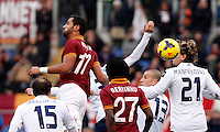 Calcio, Serie A: Roma-Genoa. Roma, stadio Olimpico, 12 gennaio 2014.<br /> AS Roma defender Mehdi Benatia, of Morocco, top left, heads to score during the Italian Serie A football match between AS Roma and Genoa, at Rome's Olympic stadium, 12 January 2014. <br /> UPDATE IMAGES PRESS/Isabella Bonotto