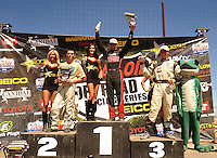 Apr 17, 2011; Surprise, AZ USA; LOORRS driver John Fitzgerald (center) Quentin Tucker (left) and Dave Mason Jr on the podium during round 4 at Speedworld Off Road Park. Mandatory Credit: Mark J. Rebilas-