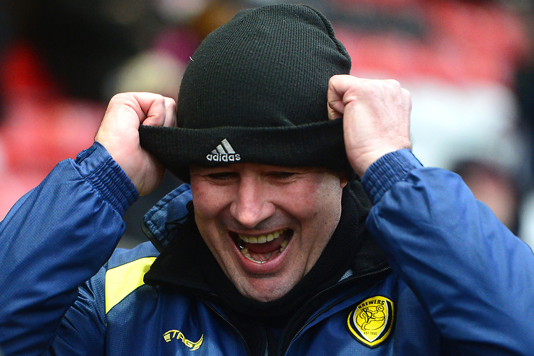 Burton Albion manager Nigel Clough puts on a wooly hat<br /> <br /> Photographer Richard Martin-Roberts/CameraSport<br /> <br /> The EFL Sky Bet League One - Saturday 15th December 2018 - Fleetwood Town v Burton Albion - Highbury Stadium - Fleetwood<br /> <br /> World Copyright © 2018 CameraSport. All rights reserved. 43 Linden Ave. Countesthorpe. Leicester. England. LE8 5PG - Tel: +44 (0) 116 277 4147 - admin@camerasport.com - www.camerasport.com