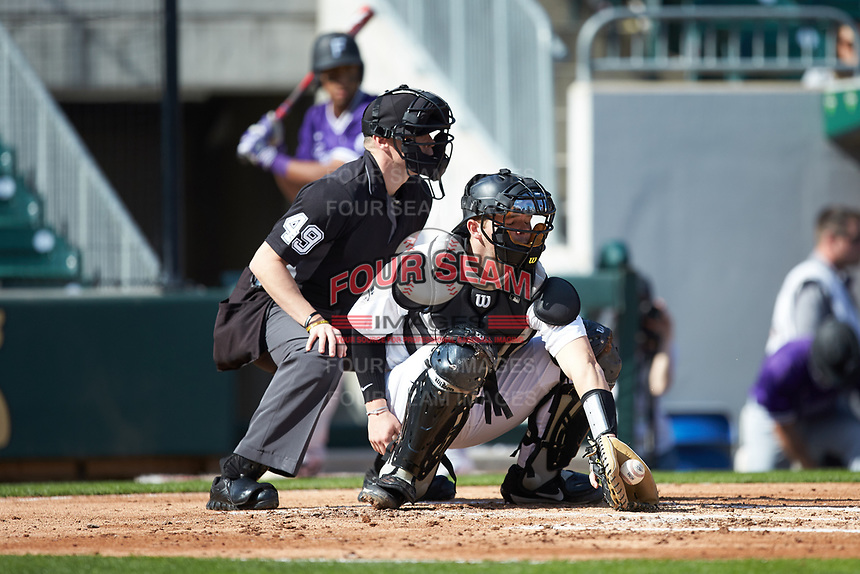 Wake Forest Demon Deacons catcher Brendan Tinsman (9) reaches for a low pitch as home plate umpire Jon Byrne looks on during the game against the Furman Paladins at BB&T BallPark on March 2, 2019 in Charlotte, North Carolina. The Demon Deacons defeated the Paladins 13-7. (Brian Westerholt/Four Seam Images)