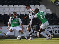 Steven Thompson (centre) tackled by George Francomb (left) and Isaiah Osbourne in the St Mirren v Hibernian Clydesdale Bank Scottish Premier League match played at St Mirren Park, Paisley on 29.4.12.