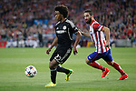 Atletico de Madrid´s Arda Turan (R) and  Chelsea´s Willian during Champions League semifinal first leg soccer match between Atletico de Madrid and Chelsea, at the Vicente Calderon stadium, in Madrid, Spain, April 22, 2014. (ALTERPHOTOS/Victor Blanco)