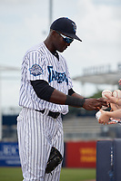 Tampa Tarpons center fielder Estevan Florial (34) signs autographs for fans before a game against the Clearwater Threshers on April 22, 2018 at George M. Steinbrenner Field in Tampa, Florida.  Tampa defeated Clearwater 2-1.  (Mike Janes/Four Seam Images)