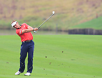 Joost Luiten (NED) plays his 2nd shot on the 11th hole during Friday's Round 2 of the 2014 BMW Masters held at Lake Malaren, Shanghai, China 31st October 2014.<br /> Picture: Eoin Clarke www.golffile.ie