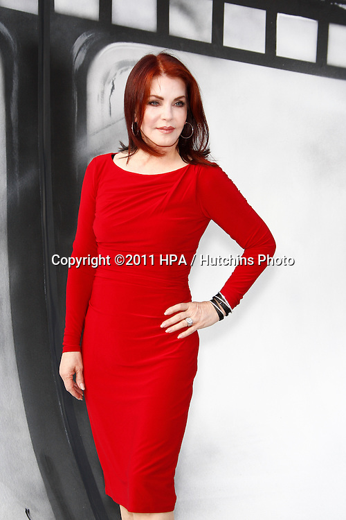 """LOS ANGELES - SEPT 25:  Priscilla Presley arriving at the """"IRIS, A Journey Through the World of Cinema"""" by Cirque du Soleil Premiere at Kodak Theater on September 25, 2011 in Los Angeles, CA"""