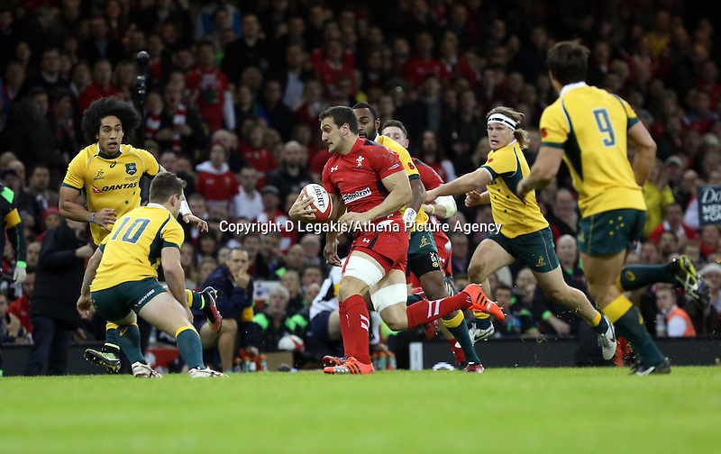 Pictured: Sam Warburton of Wales (with ball) is about to get stopped by Bernard Foley (10) of Australia. Saturday 08 November 2014<br /> Re: Dove Men Series rugby, Wales v Australia at the Millennium Stadium, Cardiff, south Wales, UK.