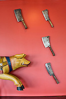 DURHAM, N.C. Tuesday August 5, 2014 - Cutlery and a vintage hog from a merry-go-round adorns the wall at The Pit Authentic Barbecue in Durham, N.C. (Justin Cook for The New York Times)