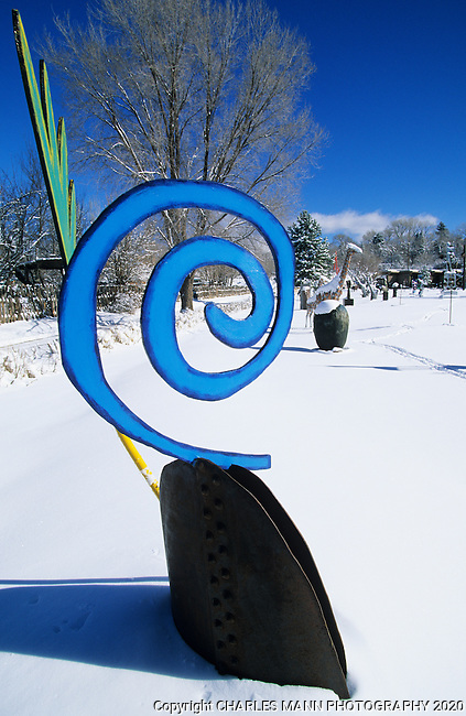 A quirky blue sculpture stands out  more that  usual during a winter snowfall at the Shidoni foundary and gallery north of Santa Fe near the village of Tesuque, New Mexico