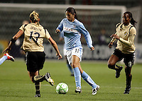 Chicago Red Star forward Cristiane (11) looks for room to maneuver in between FC Gold Pride defender Kristen Graczyk (13) and forward Kandace Wilson (9).  The defeated the FC Gold Pride defeated the Chicago Red Stars 1-0 at Toyota Park in Bridgeview, IL on May 16, 2009.