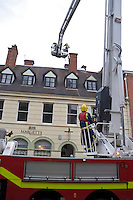 Firefighters using a Hydraulic Platform to remove storm damaged chimney pots from falling onto the streets below Warwickshire UK. This image may only be used to portray the subject in a positive manner..©shoutpictures.com..john@shoutpictures.com