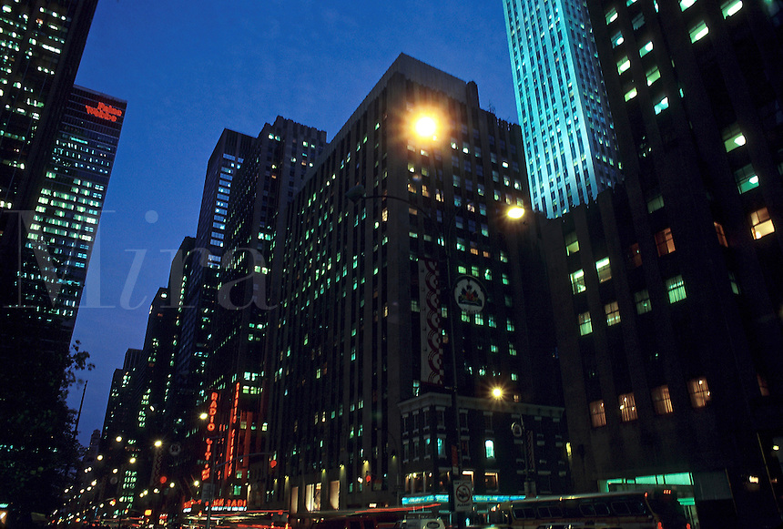 Skyscrapers in Rockefeller Center in midtown Manhattan at dusk, Glass, windows, buildings, architecture, 07-1201, 07-1000. New York City New York United States Rockefeller Center.