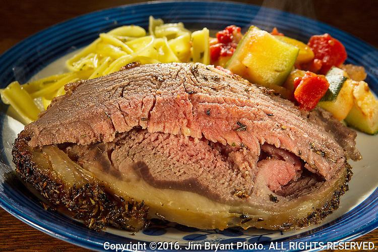 Prime Rib served with stewed tomatoes, yellow squash, onions and Zuccinhi and pasta with butter and herbs.  ©2016. Jim Bryant Photo. ALL RIGHTS RESERVED.
