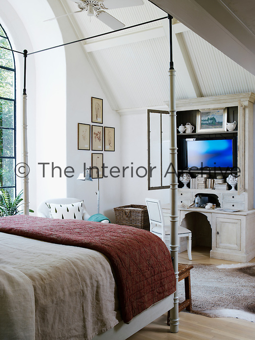 The height of the four-poster bed in the master bedroom has been extended with the addition of steel testers