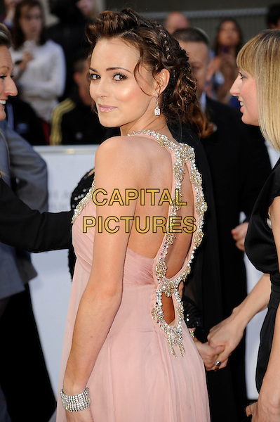 KARA TOINTON .Attending the Philips British Academy Television Awards, Grosvenor house Hotel, Park Lane, London, England, UK, May 22nd 2011..arrivals TV Baftas Bafta half length pink beige gold beaded dress cut out straps sleeveless back over shoulder rear behind bracelet  .CAP/WIZ.© Wizard/Capital Pictures.