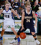 SPEARFISH, S.D. -- March 14, 2014 -- Anna Keefe #24 of Sioux Valley dribbles past Alexys Swedlund #23 of St. Thomas More during their semifinal game at the 2014 South Dakota State A Girls Basketball Tournament at the Donald E. Young Center in Spearfish, S.D. Friday. (Photo by Dick Carlson/Inertia)