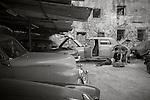 Havana, Cuba:<br /> Street scenes, auto repair lot, Old Havana