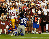 Landover, MD - September 23, 2007 -- New York Giants linebacker Kawika Mitchell (55) defends a pass intended for Washington Redskins fullback Mike Sellers (45) on second down during the final goal line stand against the Washington Redskins at FedEx Field in Landover, MD on Sunday, September 23, 2007.  The Giants won the game 24 - 17..Credit: Ron Sachs / CNP.(RESTRICTION: NO New York or New Jersey Newspapers or newspapers within a 75 mile radius of New York City)