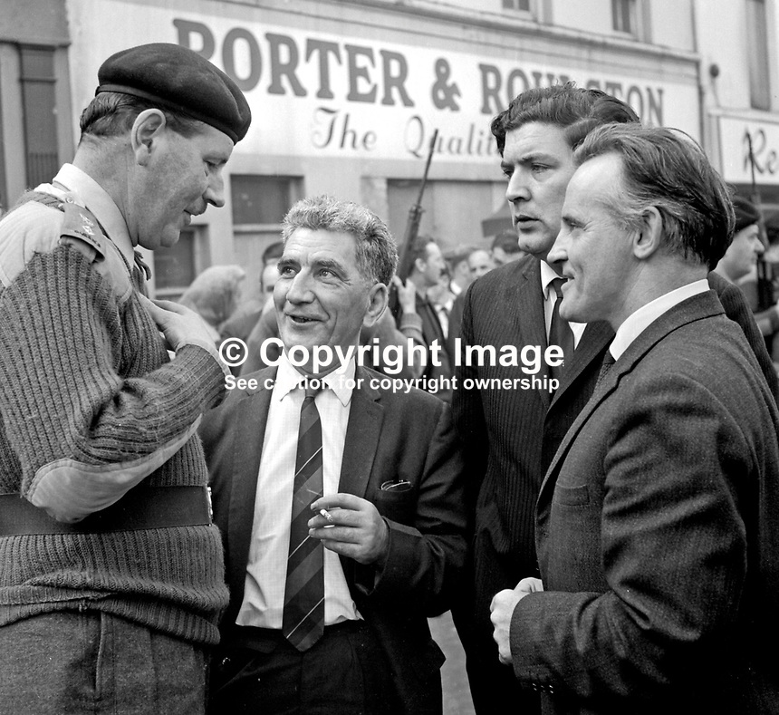 23 August 1969 - Lt Colonel Charles Millman, British Army commander in Londonderry, talking with Citizens' Action Committee members (from left) Sean Keenan, John Hume and Paddy Doherty. Millman assured Bogsiders that the army would protect them if they decided to pull down the barricades. He further said: There is no question of us departing. I am on a four month tour in N Ireland. 196908230001.<br />