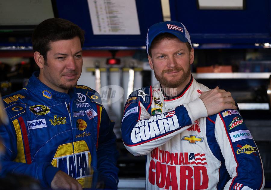 Mar. 1, 2013; Avondale, AZ, USA; NASCAR Sprint Cup Series driver Dale Earnhardt Jr (right) with Martin Truex Jr during practice for the Subway Fresh Fit 500 at Phoenix International Raceway. Mandatory Credit: Mark J. Rebilas-