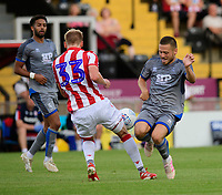 Lincoln City's Jack Payne vies for possession with Stoke City's Lasse Sorensen<br /> <br /> Photographer Chris Vaughan/CameraSport<br /> <br /> Football Pre-Season Friendly - Lincoln City v Stoke City - Wednesday July 24th 2019 - Sincil Bank - Lincoln<br /> <br /> World Copyright © 2019 CameraSport. All rights reserved. 43 Linden Ave. Countesthorpe. Leicester. England. LE8 5PG - Tel: +44 (0) 116 277 4147 - admin@camerasport.com - www.camerasport.com