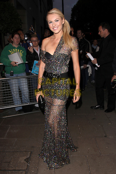 ZOE SALMON.The Ndoro Children's Charities fundraising gala at The Dorchester Hotel, London, England. .September 17th, 2009 .full length black bustier layered layers sparkly dress long maxi waist belt clutch bag sheer see through side ponytail one shoulder .CAP/AH.©Adam Houghton/Capital Pictures.