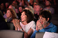 NWA Democrat-Gazette/ANDY SHUPE<br /> Jill Waruszewski (center) and her mother, Sherry Patton, both of Fayetteville, applaud Thursday, May 9, 2019, while watching Waruszewski's son perform in Farnahan's Circus at The New School in Fayetteville. The school has been performing the circus for pre-kindergarten students for about 30 years.