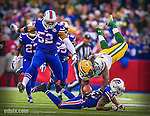 14 December 2014: Green Bay Packers running back Eddie Lacy dives to cap a 15-yard gain in the first quarter against the Buffalo Bills at Ralph Wilson Stadium in Orchard Park, NY. The Bills defeated the Packers 21-13, snapping the Packers' 5-game winning streak and keeping the Bills' 2014 playoff hopes alive. Ed Wolfstein Photo. Original shot Nikon D4 RAW (NEF)