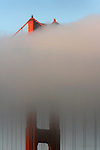 The Golden Gate Bridge from the Marin side stood half in the fog and half in the sunshine.