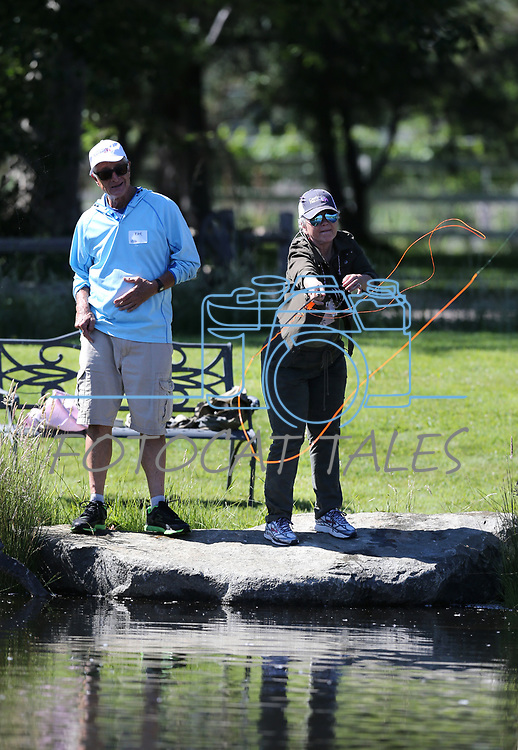 Breast cancer survivor Diana Preston learns to flyfish with guide Kirk Chiapella during a Casting for Recovery retreat in Gardnerville, Nev., on Friday, June 30, 2017.  <br /> Photo by Cathleen Allison/Nevada Photo Source