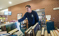 NWA Democrat-Gazette/BEN GOFF @NWABENGOFF<br /> Chuck Pribbernow, president of the Friends of the Bentonville Library, sorts and shelves donated books Tuesday, March 20, 2018, at the Friends of the Bentonville Library's Read it Again Book Store at the Bentonville Public Library. The group has their semiannual book sale coming up at the library, open to the public from 9:00 a.m. to 4:30 p.m. April 6-7.