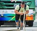 HAINAN ISLAND, CHINA - AUGUST 23:  Mike Jenkins of USA competes at the Truck Pull event during the World's Strongest Man competition at Serenity Marina on August 23, 2013 in Hainan Island, China.  Photo by Victor Fraile
