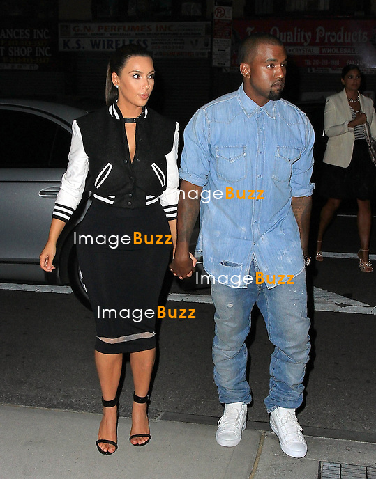 Kim Kardashian and Kanye West walk hand-in-hand into  the four stars Nomad restaurant, for a very romantic dinner in New York City..New York, September 12, 2012.