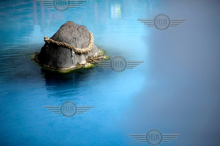 A rock, surrounded by steam, protrudes from the hot spring Kamado Jigoku (Oven Hell) in Kamado, Beppu. This resort town contains nine major geothermal hot spots, which are sometimes referred to as the 'Nine Hells of Beppu'. /Felix Features
