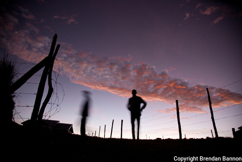 Johanna Kariankei, 17, right and his coach Elias Maindi warm up for a morning run outside Eldoret, Kenya..