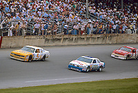 Geoff Bodine, #5 Rick Hendrick Levi Garrett Chevrolet, Buddy Baker #88 Crisco Oldsmobile, Bill Elliott #9 Harry Melling Coors Ford, action, Daytona 500, Daytona International Speedway, Daytona Beach, Florida, February 15, 1987. (Photo by Brian Cleary/www.bcpix.com)