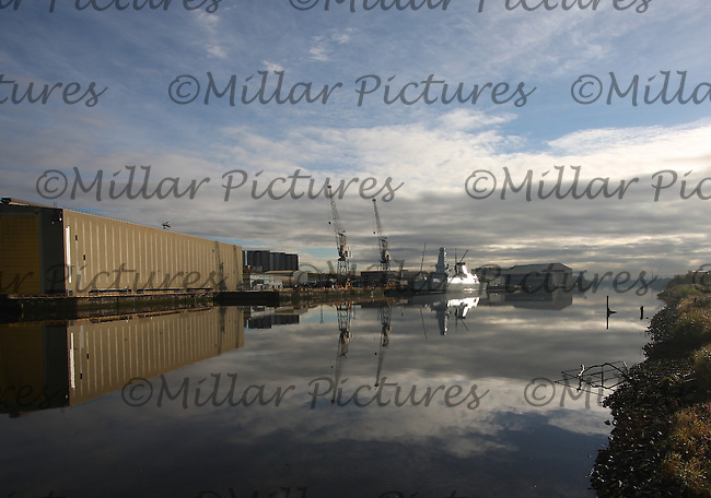 General view of the River Clyde at Glasgow showing HMS Duncan berthed at BAE Scotstoun.