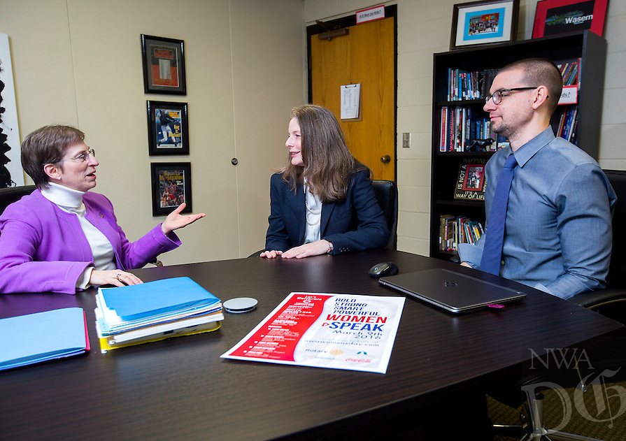NWA Democrat-Gazette/JASON IVESTER<br /> Beth Keck (from left), Ann de Vona (cq), co-chairs for the International Women's Day, chat with Jeff Wasem (cq), Old High Middle School principal, on Thursday, Feb. 25, 2016, inside the Bentonville school.