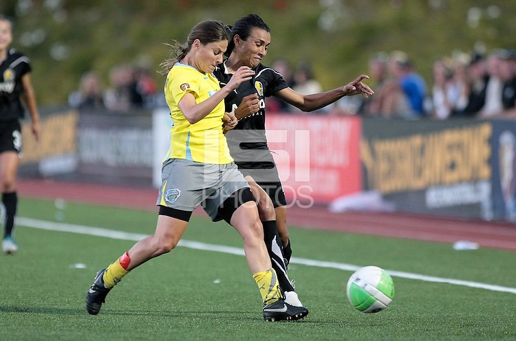 Marta (right) battles to maintain possession against Tina Dimartino (left). Regular season champions, FC Gold Pride defeated the Philadelphia Independence 4-1 at Pioneer Stadium in Hayward, California on September 11th, 2010.