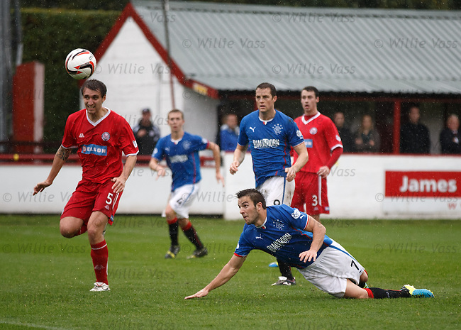 Andy Little comes close with a diving header