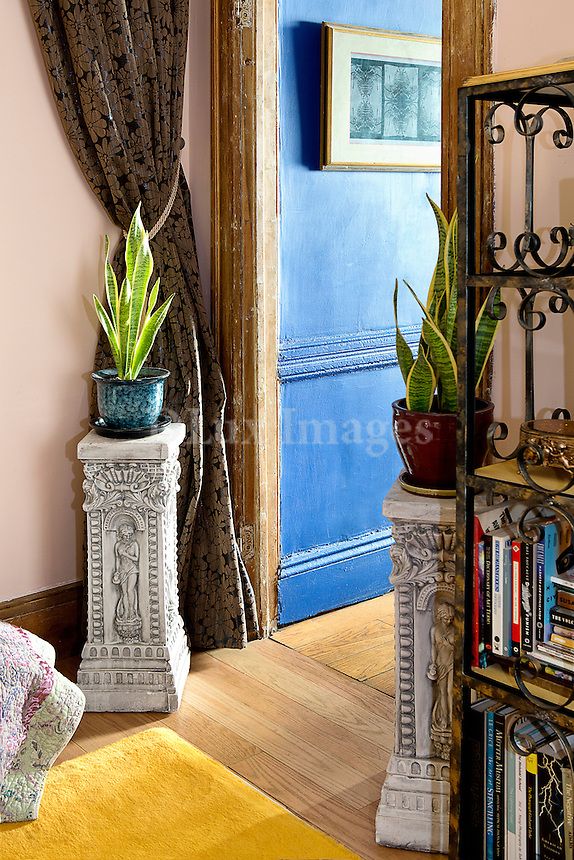 Flowerpots on carved stands