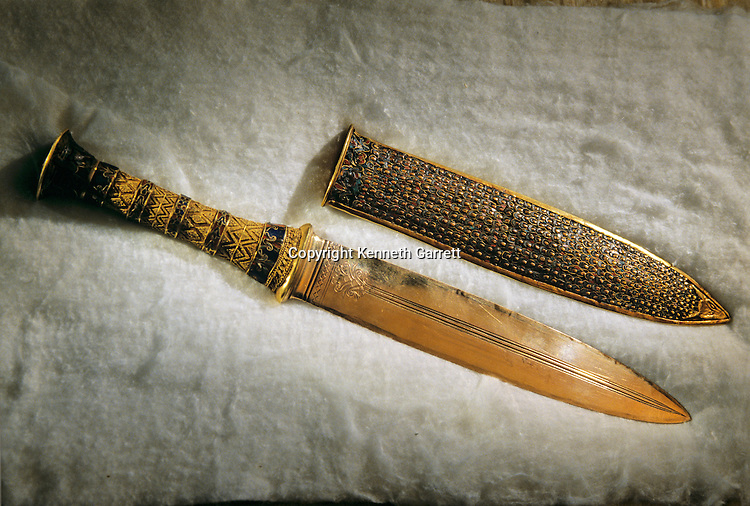 Gold ceremonial daggar and sheath, Tutankhamun and the Golden Age of the Pharaohs, Page 273